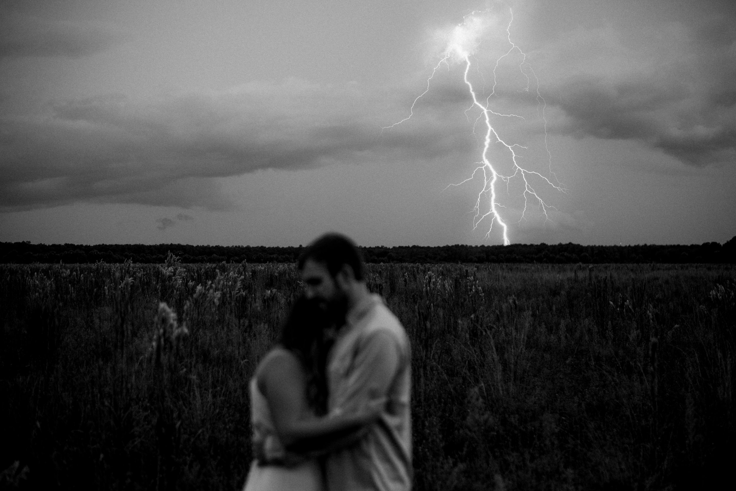 Jaeden & Mackenzie Hamernik Couple Portrait Session in an open field in Naples Florida during the stormy season. This moment embodies to keep faith that everything will be okay
