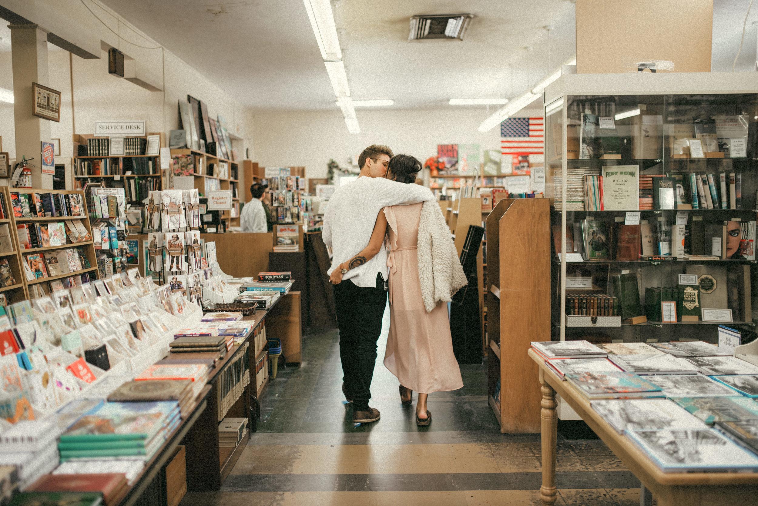 Hillary & Brandon walking out of bookstore - couple portraits - st pete florida - naples florida wedding photographer - tampa wedding photographer
