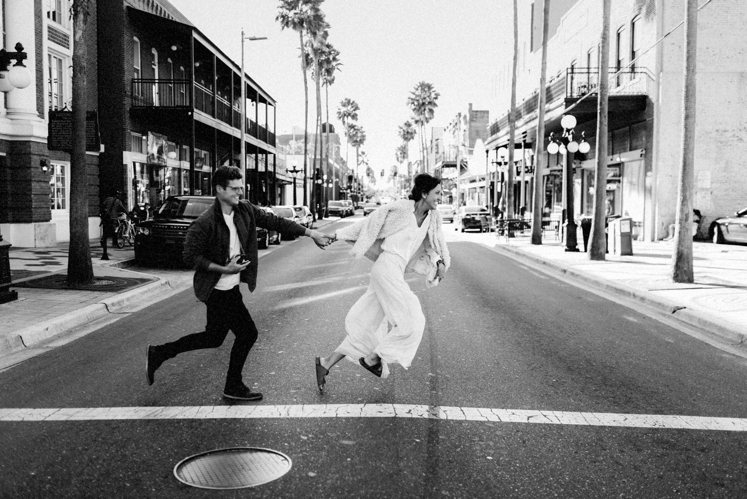 Brandon & Hillary running in Ybor Tampa Florida - couple portraits - st pete florida - naples florida wedding photographer - tampa wedding photographer