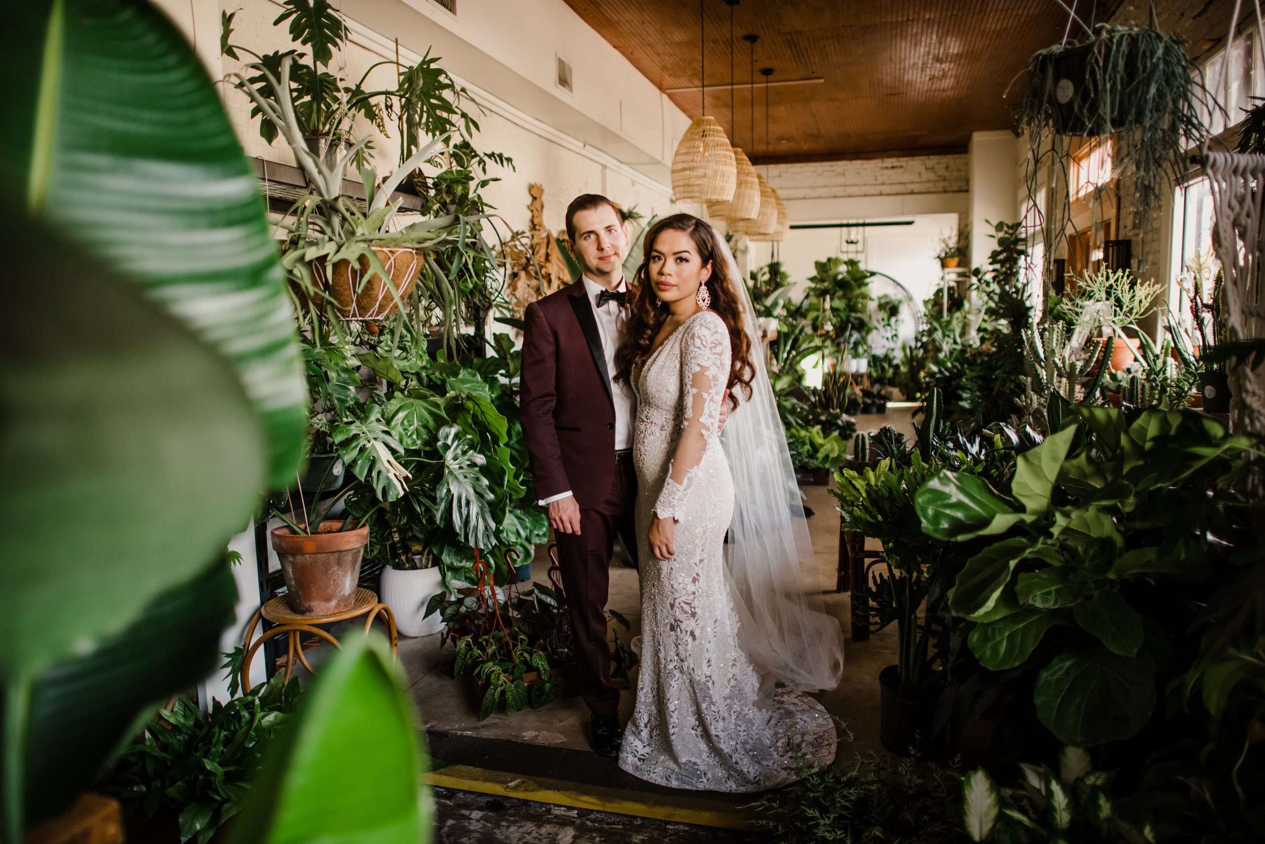 Bride and Groom posing for their bridal portraits at Fancy Free Nursery in Tampa Florida
