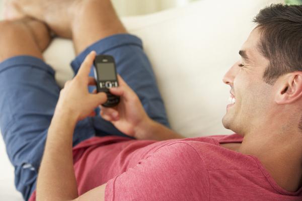 texting male sofa.jpg