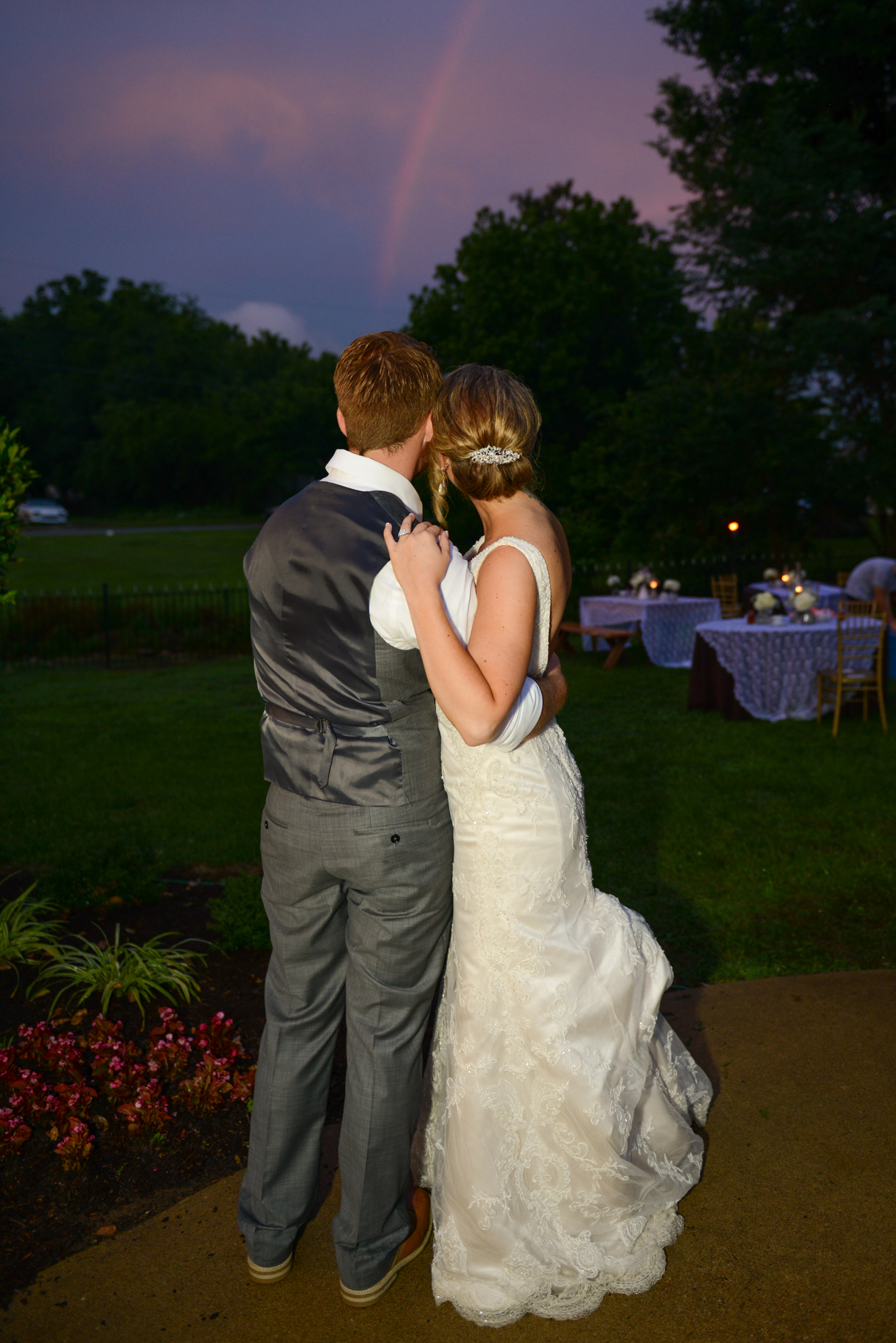 After a rainy outdoor ceremony and reception, Nikkie & Zach were rewarded with a beautiful rainbow at their reception.