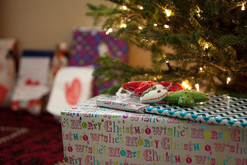 lit tree and presents