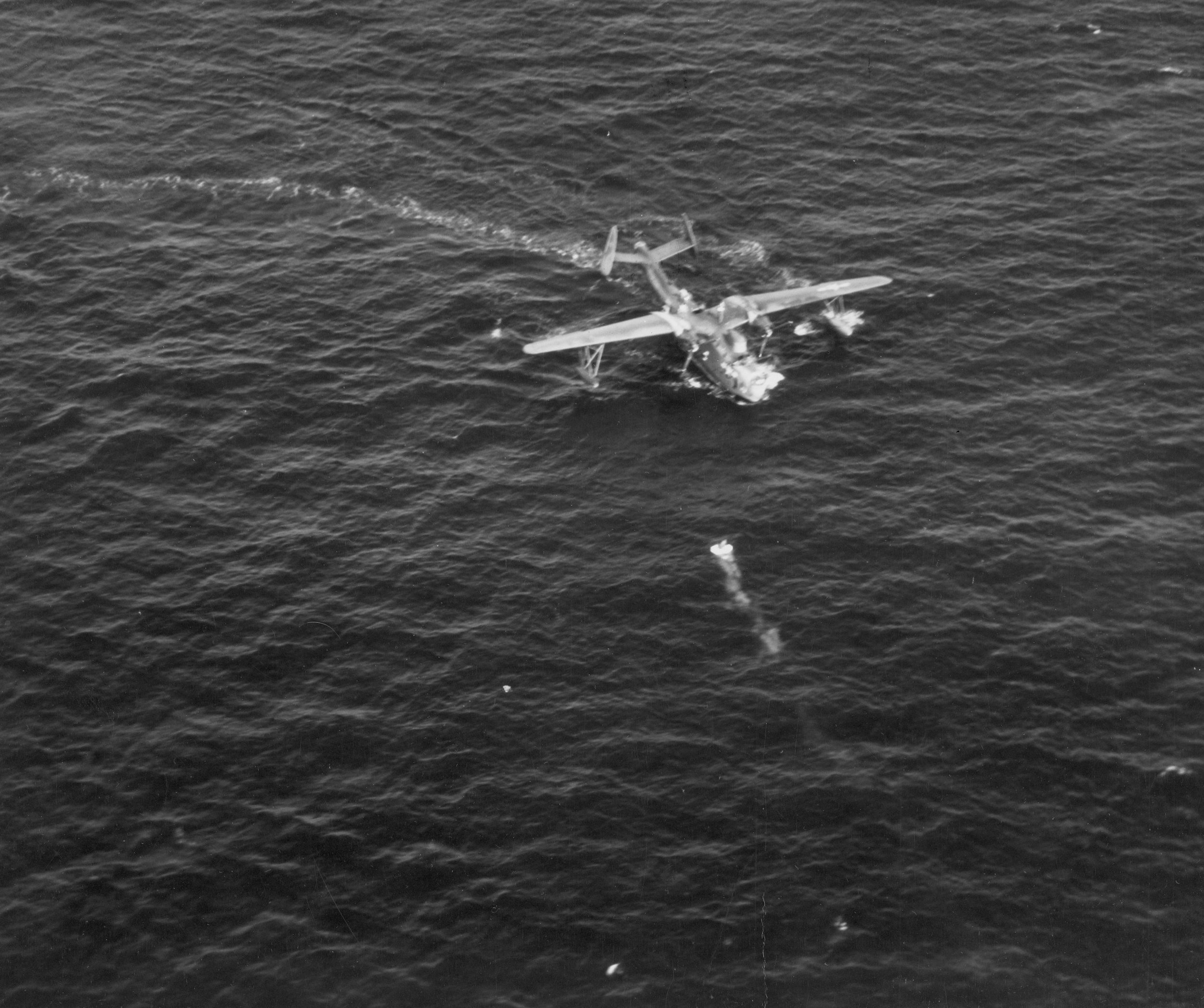 A welcome sight. A PBM Mariner finds a life raft with a pilot. Credit: Lost in the Pacific/National Archives
