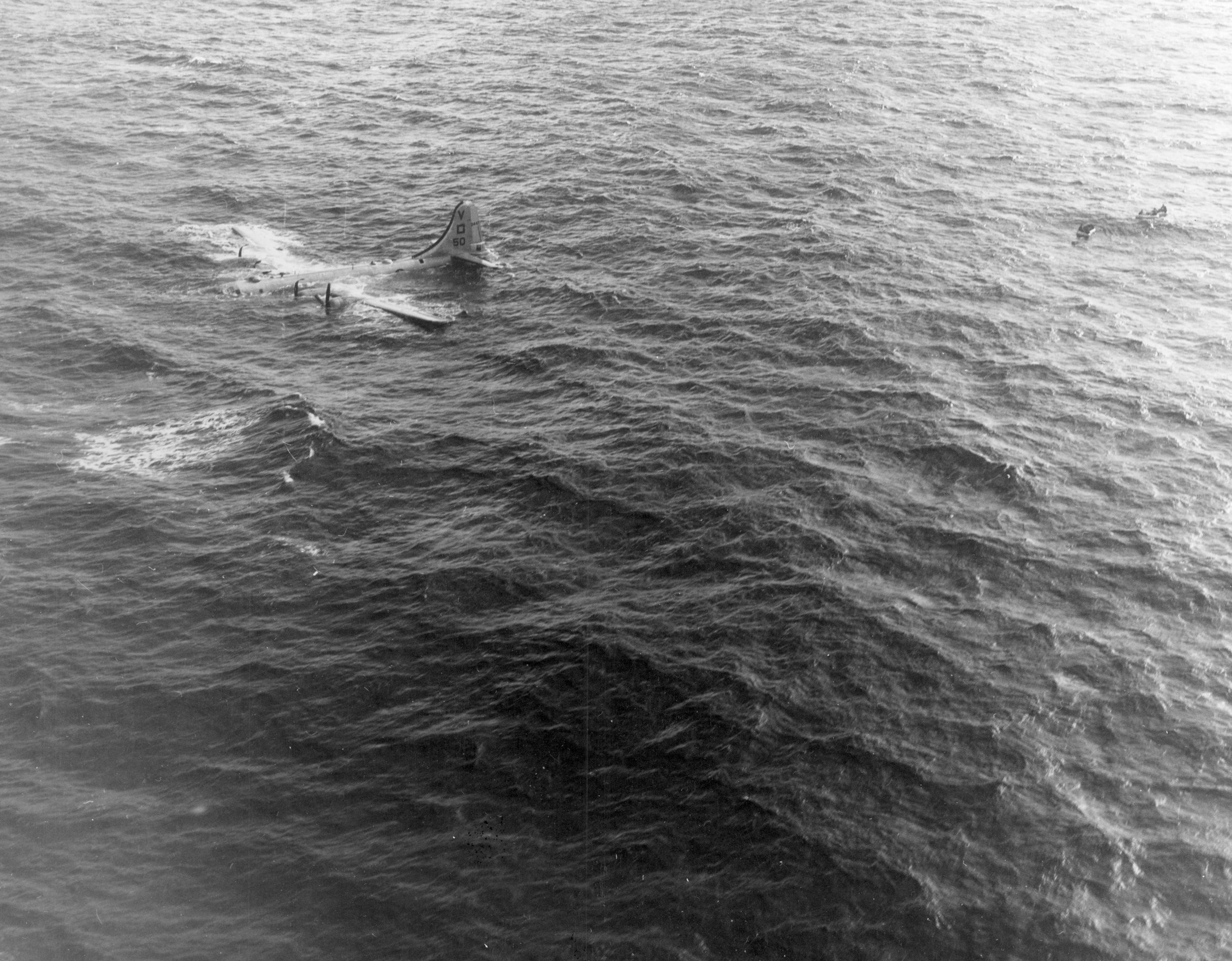 A B-29 settles into the ocean. The life rafts are to the right.. Crews often drifted for days if not weeks. Credit: Lost in the Pacific/National Archives