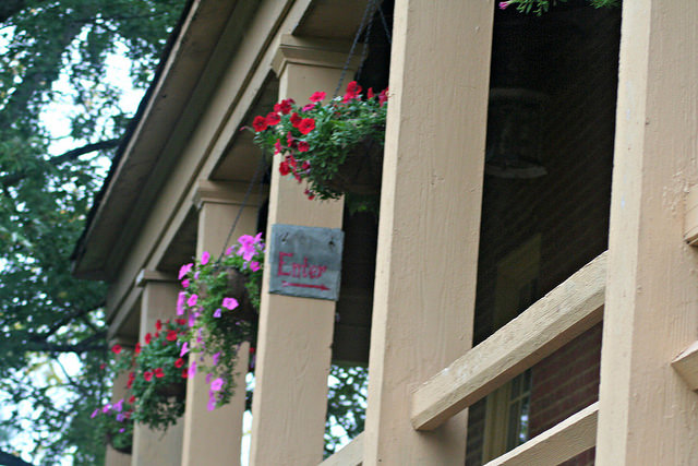 Hanging flower baskets on the front porch