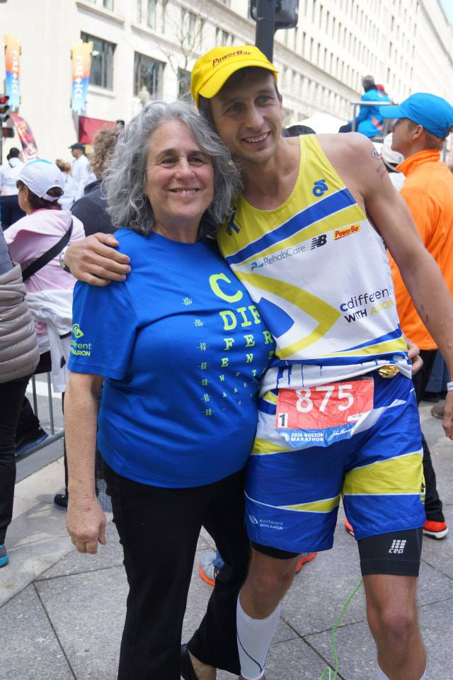 Here's executive director of the M.A.B. Barbara Salsbury modeling the CDWA Boston Strong Eye Chart shirt and myself modeling the Special Edition Champion Systems Boston race kit.