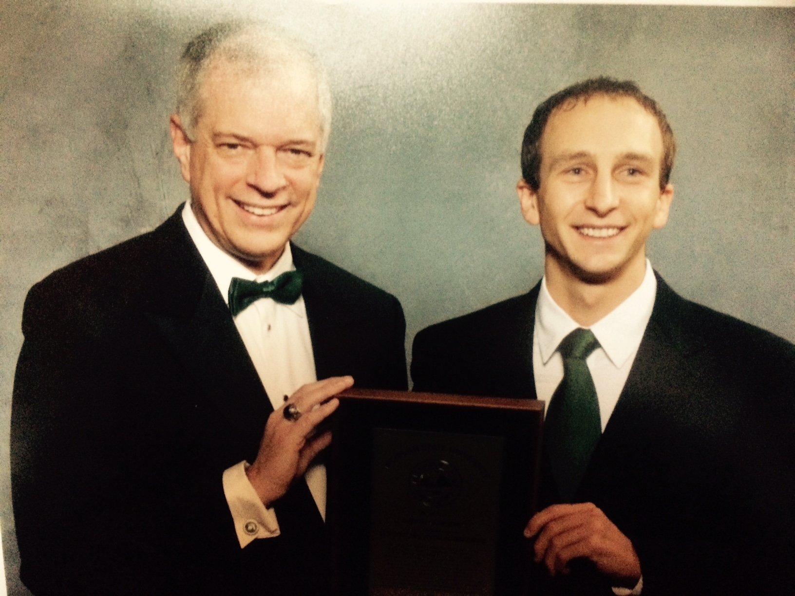 """Everyone that knows me knows that every day I wake up and tell myself """"Its a Great day to be a Spartan""""  Well in 2010 I was so honored to be chosen as the Distinguished Young Alumni at the Grand Awards Ceremony during Homecoming weekend. Here I am with MSU Alumni President Scott Westerman receiving the award. The Spartans won that weekend on a historic game winning Hale Mary that Keith Nichols reached across the goal line for the win!"""
