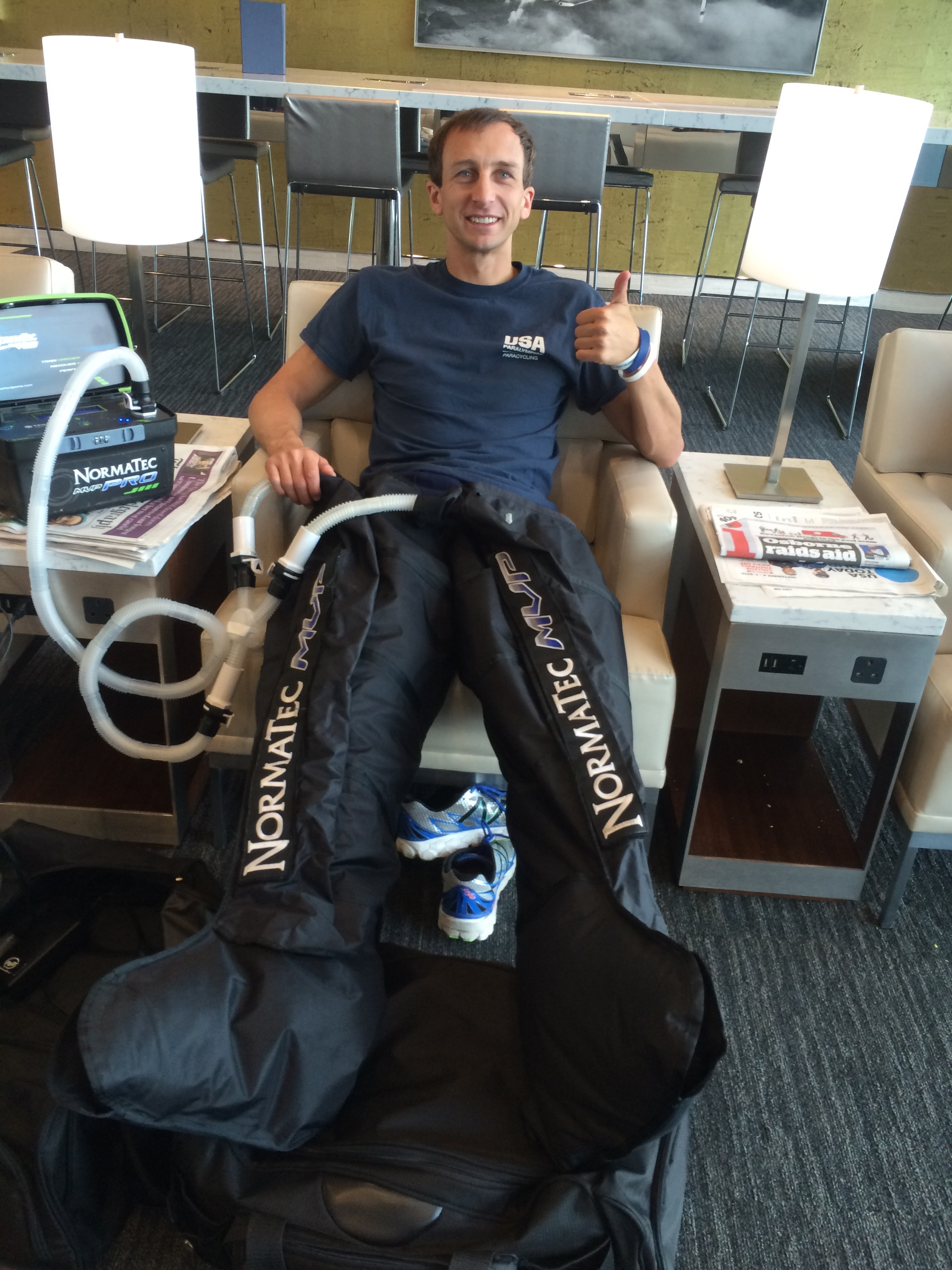 Recovering between races using the NormaTech boots to flush the legs.