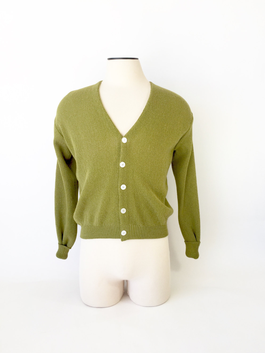 Awesome green boucle cardigan sweater circa 1960s. Great shell buttons and a classic staple in most men's wardrobes of the era..