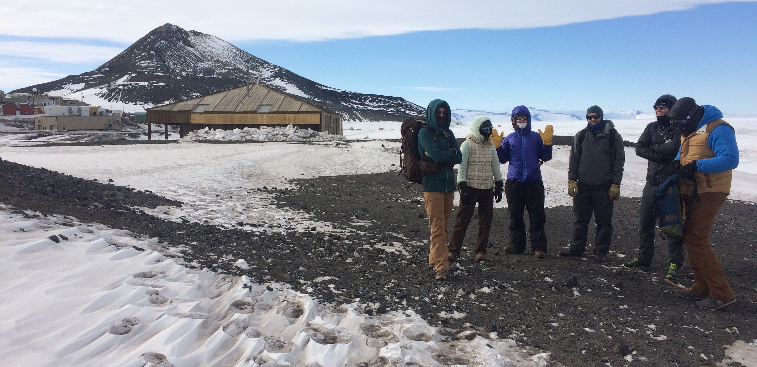 Our brave crew, Discovery Hut in the background.