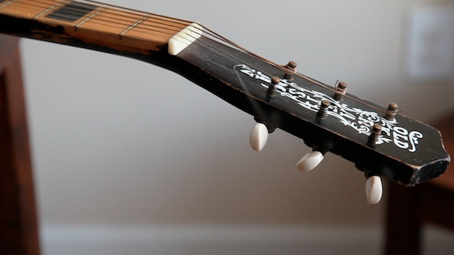Little G Weevil's Old Kraftsman guitar.