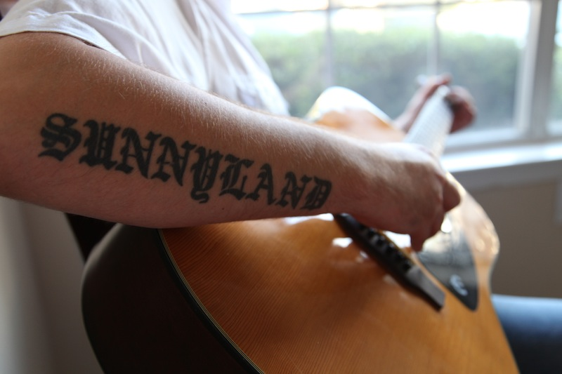 Little G's forearm tattoo honors Sunnyland Slim, a Blues piano player in the 1940s and 50s. it's also his first son's middle name.