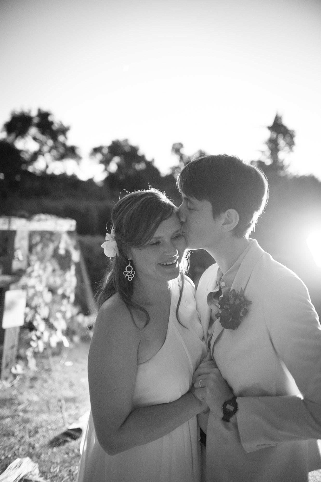 two brides kissing