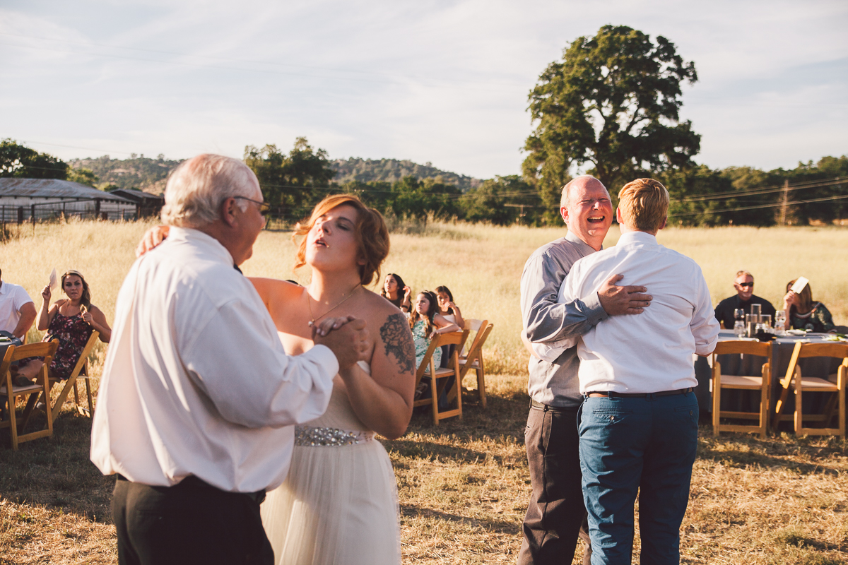 lesbian brides dancing with dads