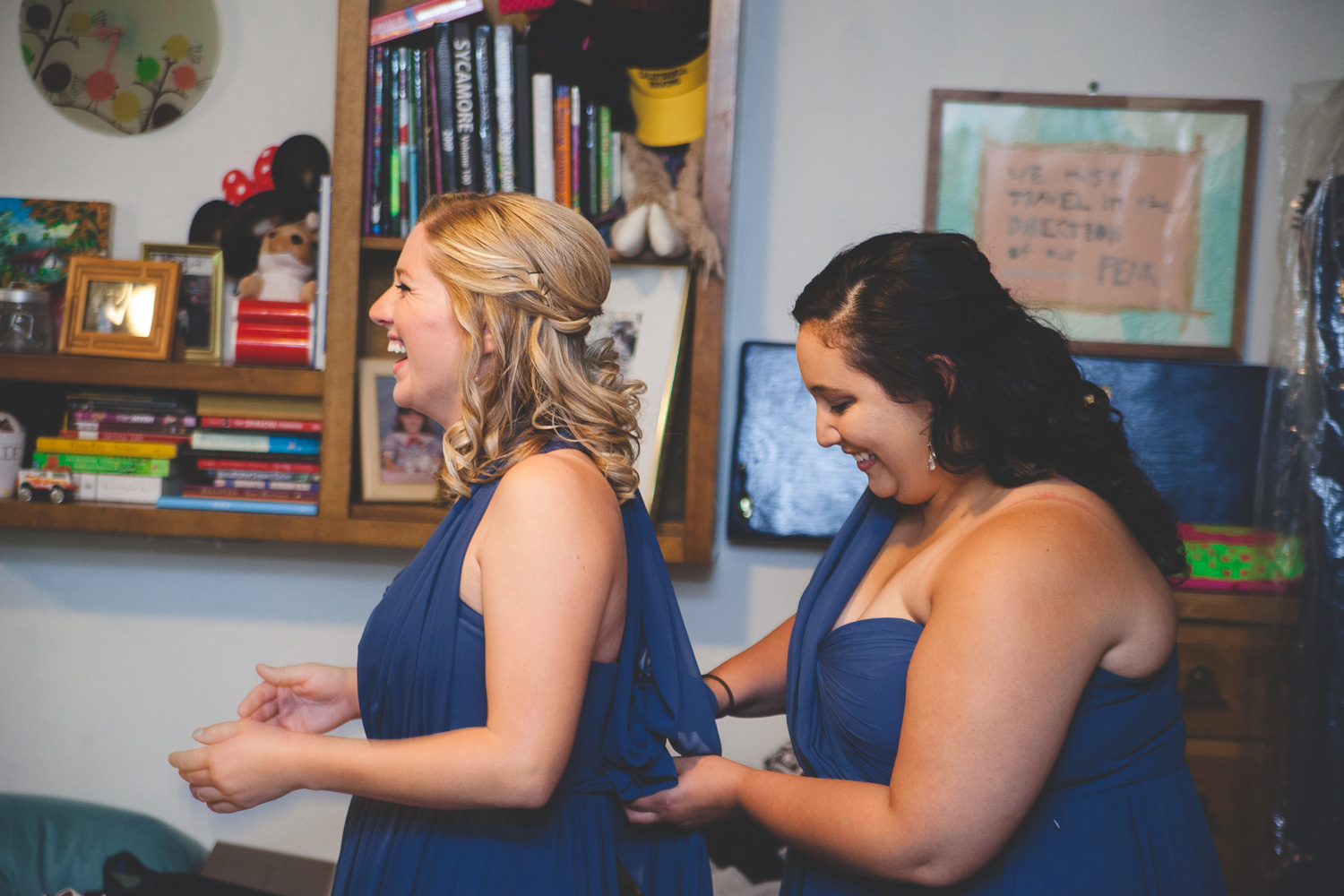 bridesmaids in navy dresses getting ready
