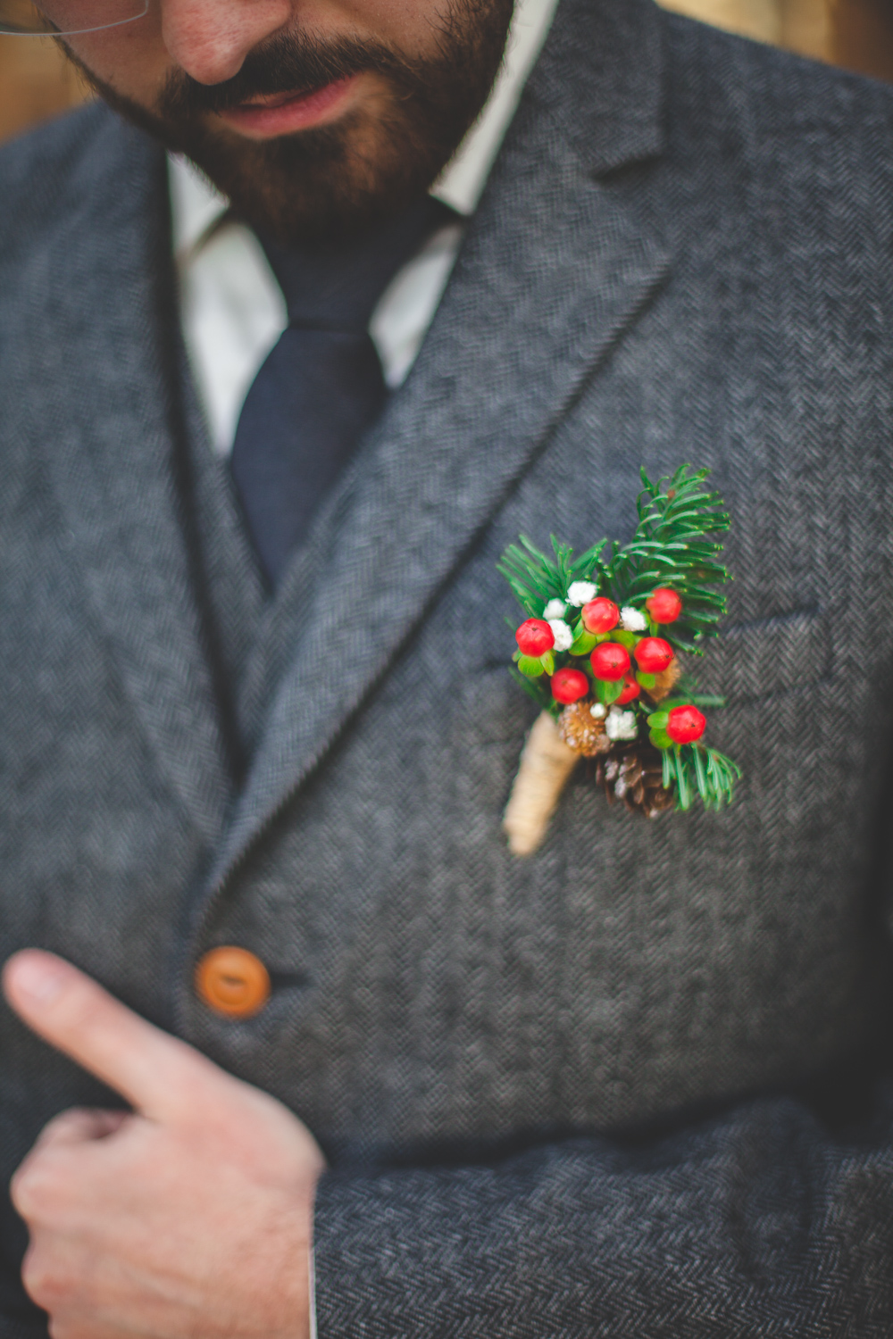 pinecone holly berry boutonniere