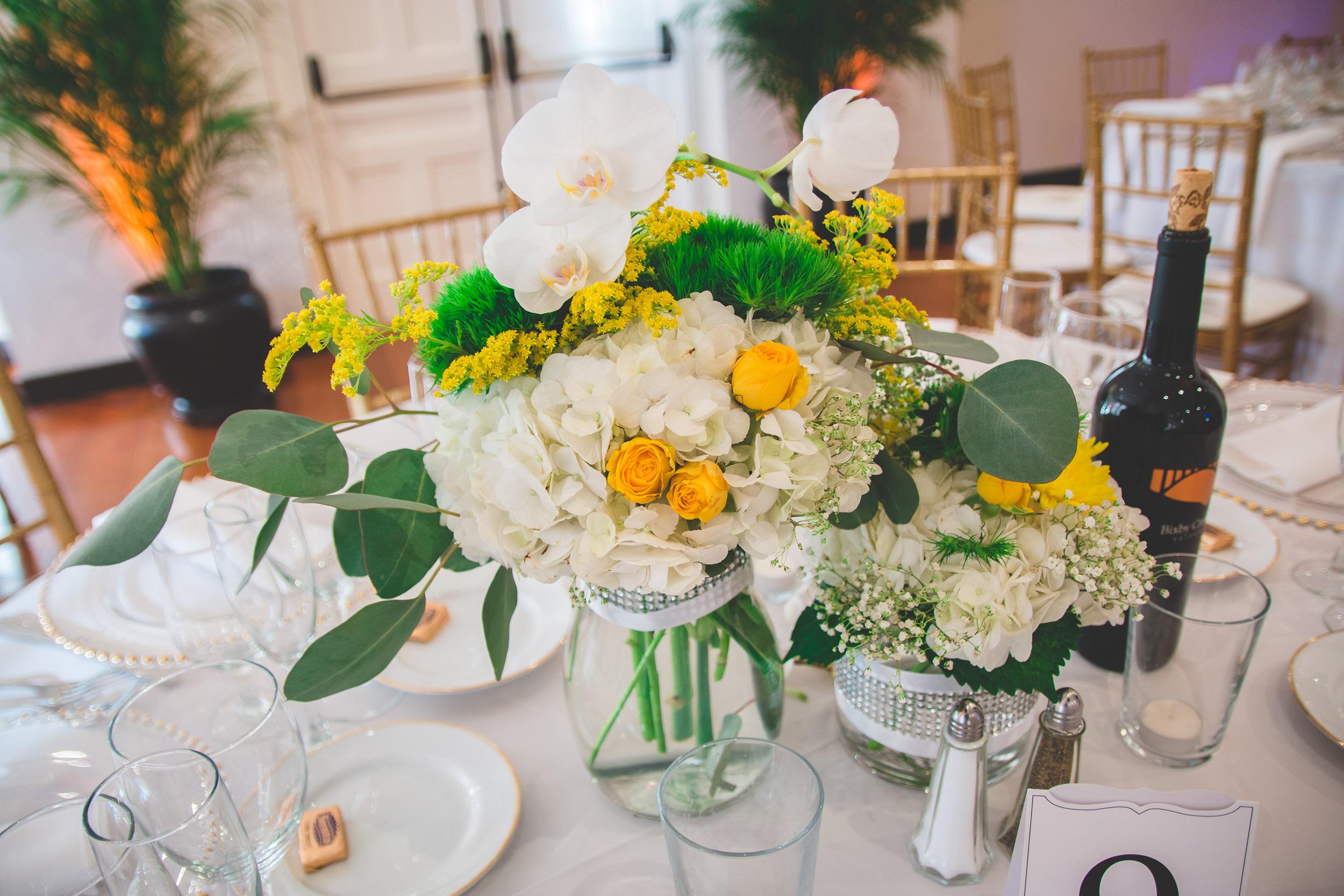white and yellow wedding centerpiece