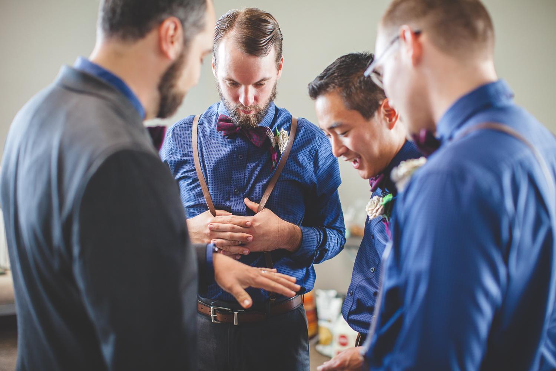 groomsmen looking at ring