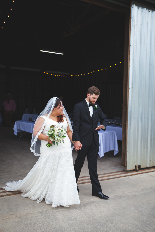 groom looks at wedding ring