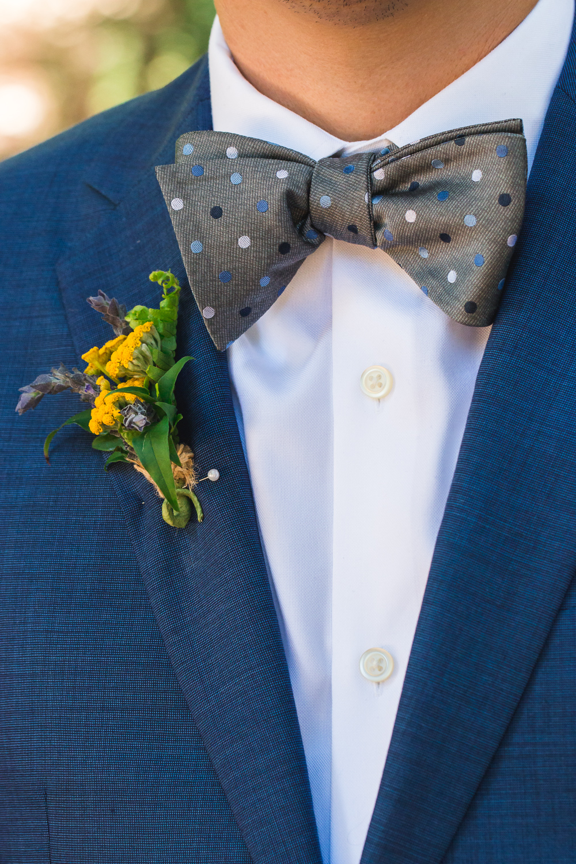 blue suit grey bowtie yellow boutonniere