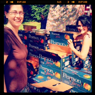 Chef Courtney buying local Pearson Farms peaches
