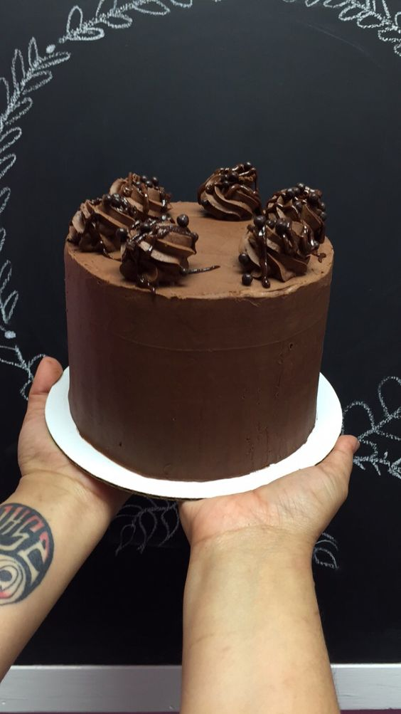Chocolate Wasted - 3 layers of chocolate cake filled and frosted with whipped chocolate ganache. topped with chocolate ganache and chocolate rice crisps.   6 inch $40 8 inch $50