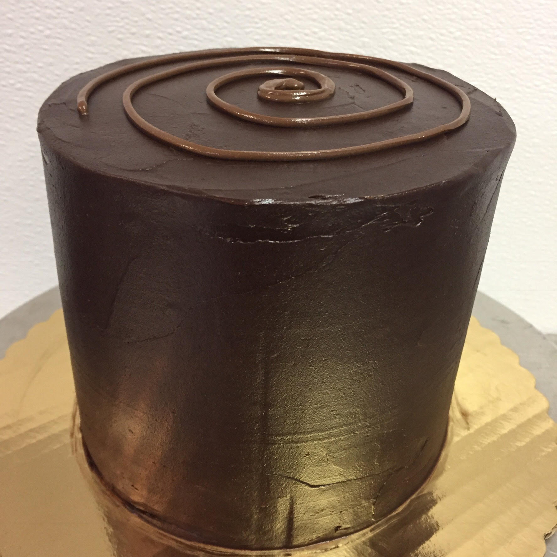 Nutella - 3 Layers of Chocolate cake filled with Nutella. Frosted with chocolate ganache. Topped with a Nutella Swirl   6 inch $40 8 inch $50