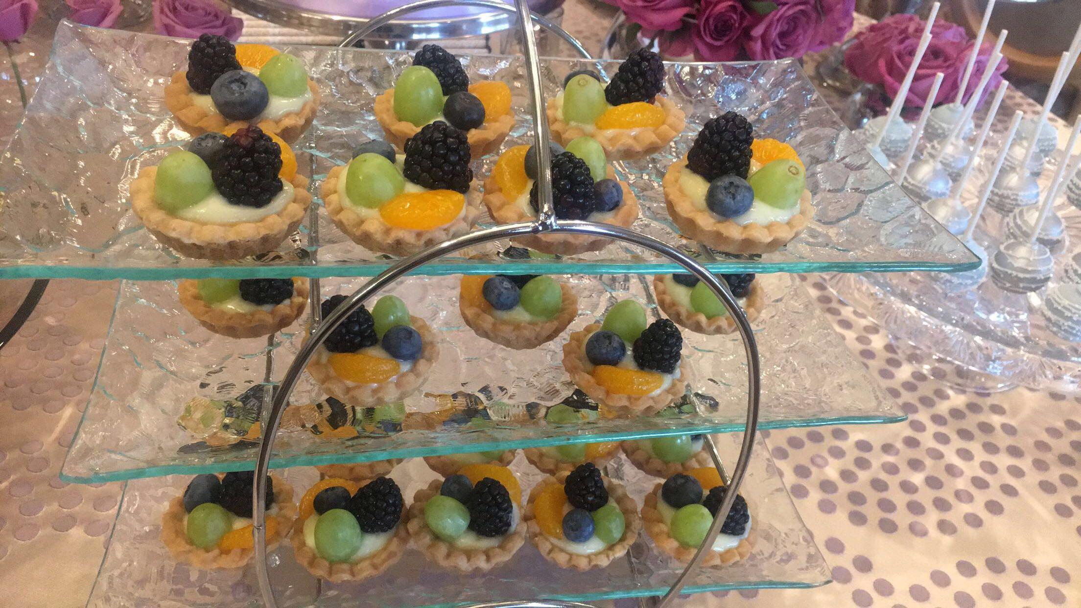 Fresh Fruit Tartlets - Seasonal fruit atop Vanilla Pastry cream in a buttery shortbread shell.
