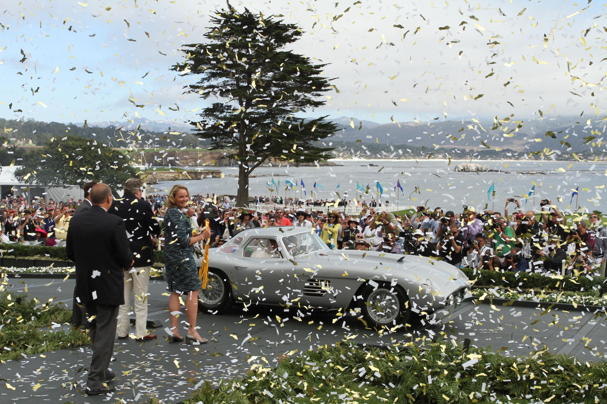 "Chairman, Sandra Button ready to present the ""Best of Show"" to the 1954 Ferrari 375 MM Scaglietti Coupe during DaVinci Fusions' grand finale!"