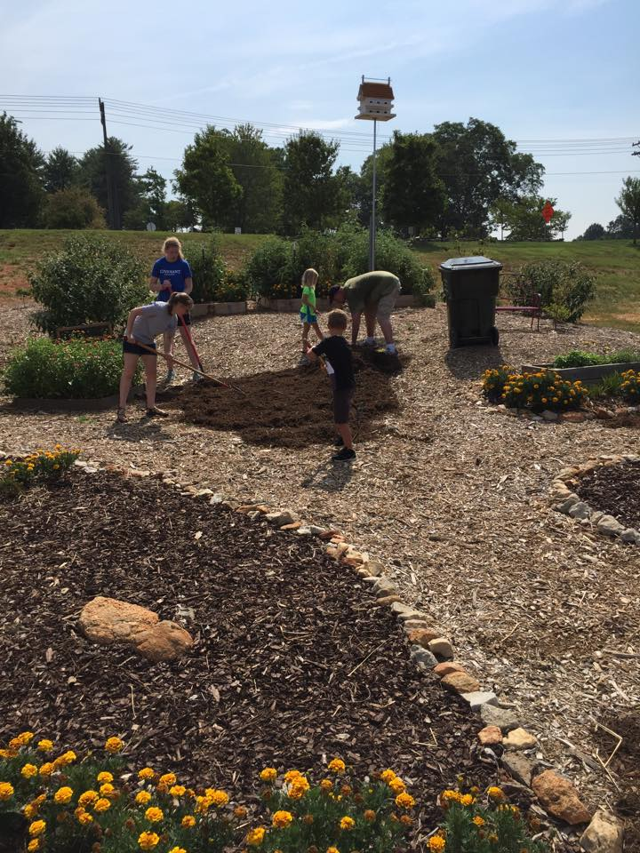 Haven Ridge Church members helping out in the O'Neal Village community garden