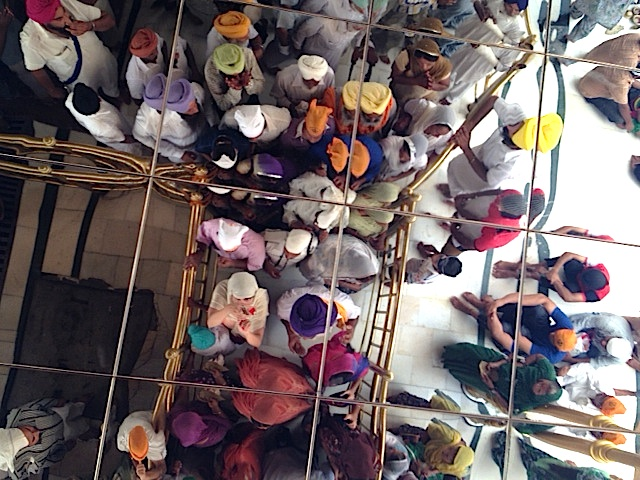 Before I am 'known' at my book event, I head alone into a crowd of unknown people at The Golden Temple in Amritsar. This is a picture of us reflected in the mirror above our heads.