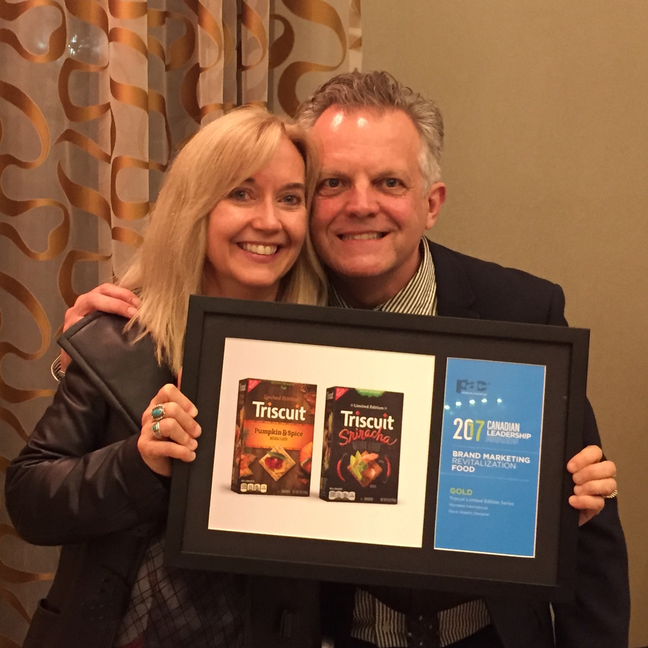 Linda Ranson-Smith, Designer, and Chris Plewes, VP Creative Director, with the award for Triscuit Limited Editions