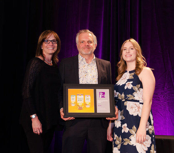 Davis' Linda McGregor, VP Account Director, Chris Plewes, VP Creative Director, and Emily Wiebe, Designer accepted the award for Earth's Own.