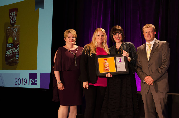 Karen Tsoutos, Marketing Brand and Graphics Manager at Weston, and Sara Merrifield, VP Account Director at Davis, accepted the award for Country Harvest's redesign.