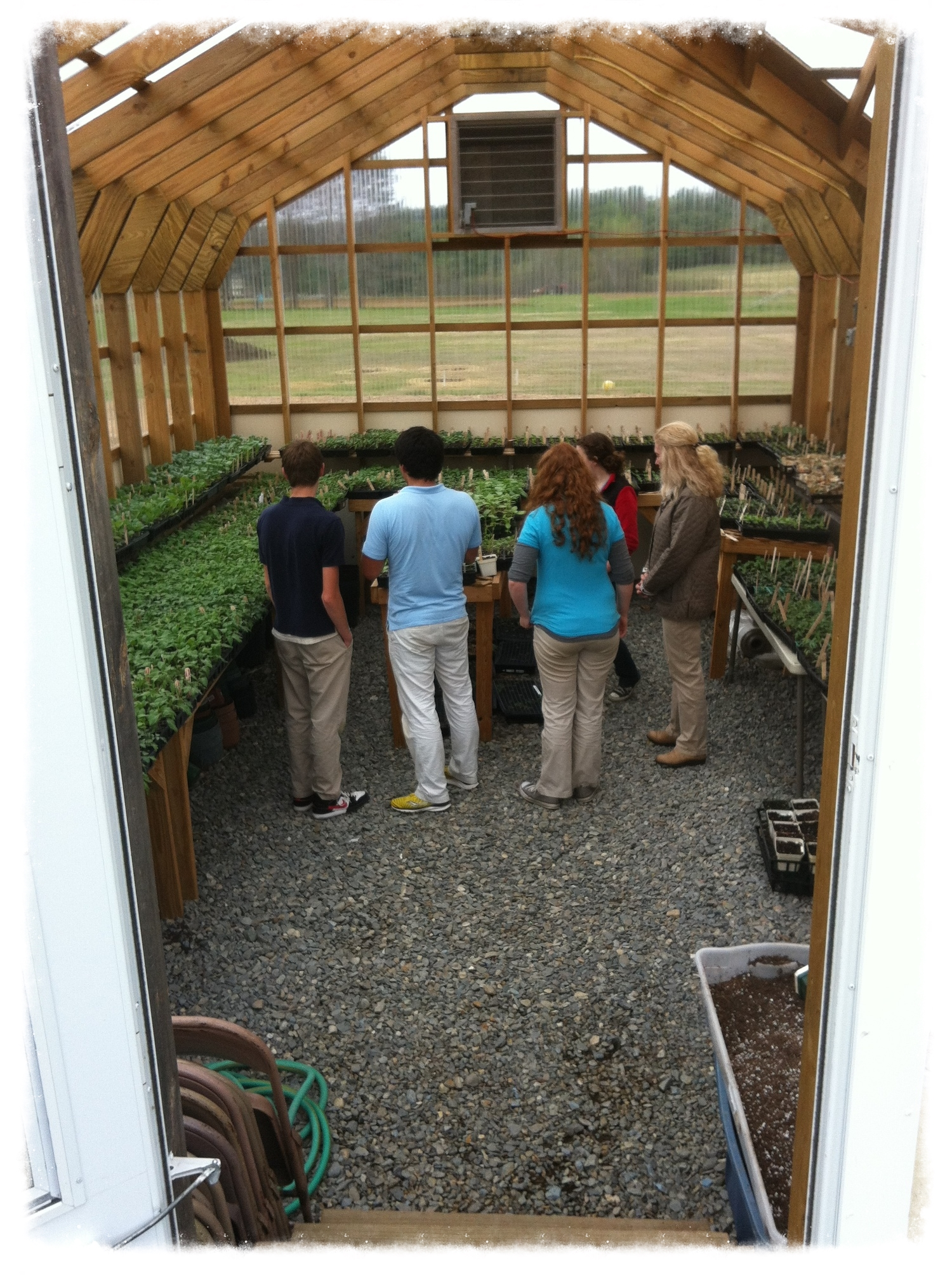 Students at Riverview Memorial School students showing off their greenhouse while on our tour.