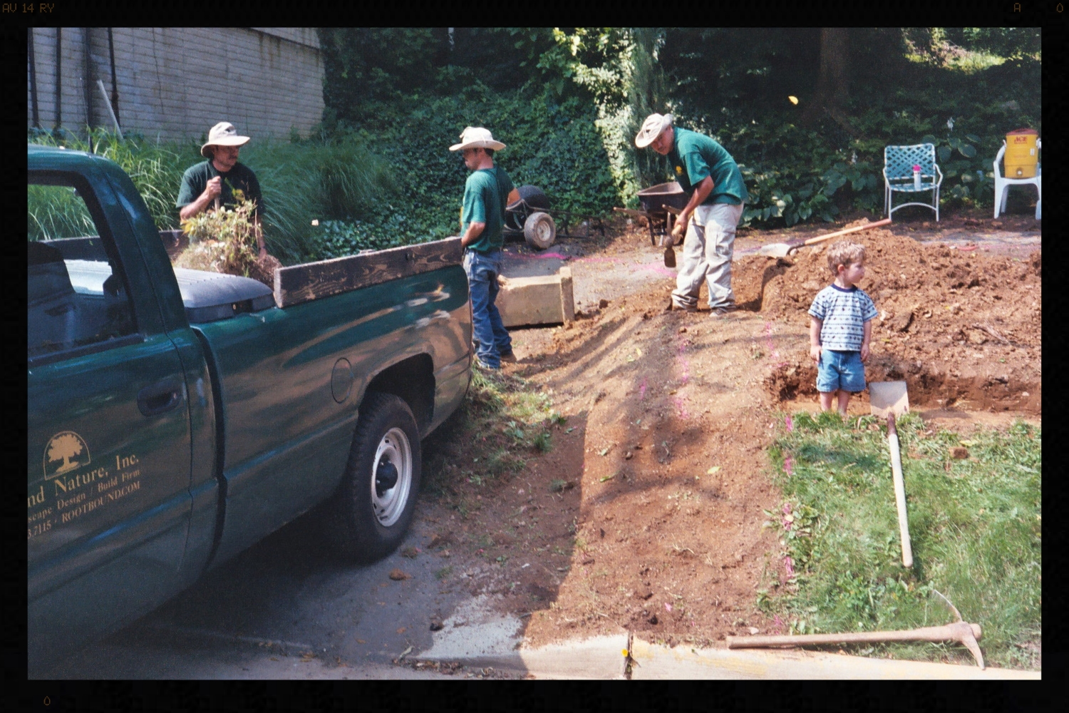 Hudson as an early landscaper inspecting a footer.