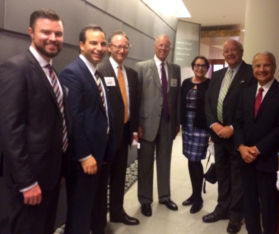 From left: Mike Brown '06, Sinan Kanatsiz '97 (MBA '00), Lawrence Armstrong, Parker Kennedy, Lynne Doti, Honorable Finbar Hill, and President Jim Doti