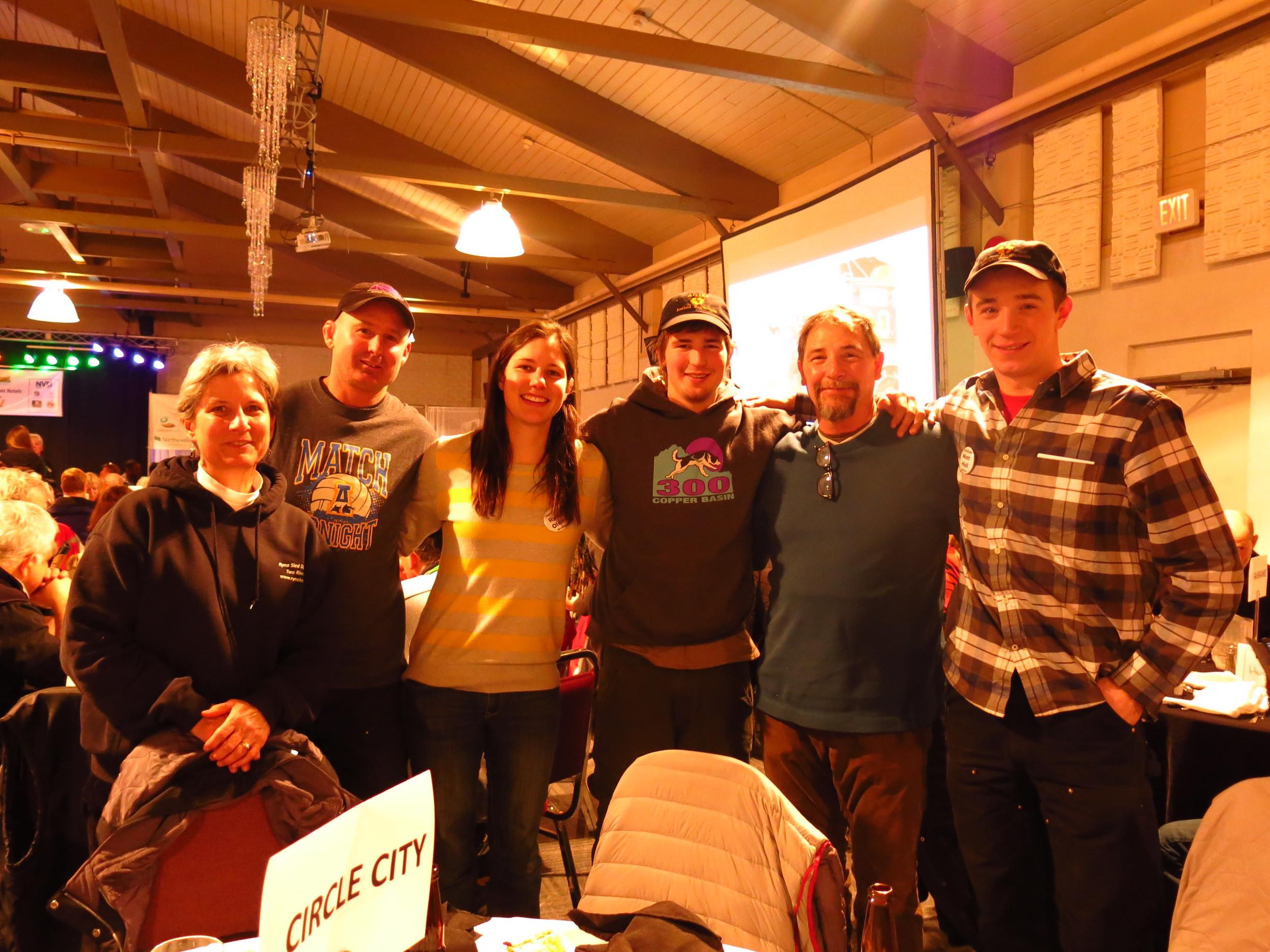 Left to right: Katy (Ryne mom), Derek, Ryne, Riley, Keith (Riley's dad, Matt's handler), Matt (Quest musher)
