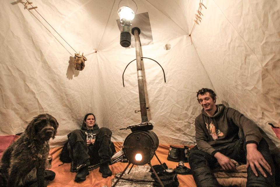 Jezzy, Matt, and I enjoying the warmth of the wood stove. (photo by Amanda Brooks)