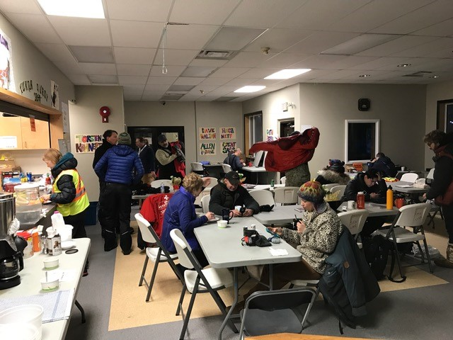 A quiet, dark space is saved in the back of this room for handlers and volunteers to catch a nap while waiting for mushers (thanks Pelly Crossing!)