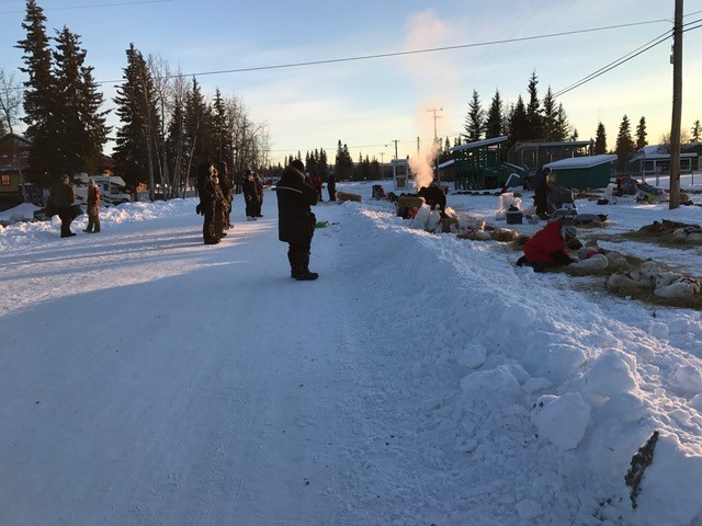 The mushers resupply their bags and fix their sleds.