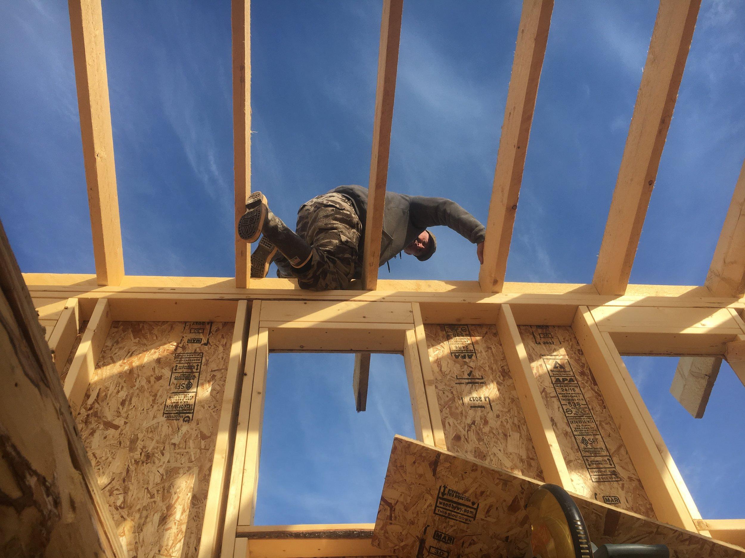 Derek climbing the rafters.