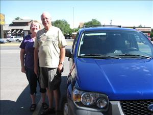 """""""Two months after the fact: We are enjoying the '06 Ford Escape, and are glad we took your advice about it. It has all the features we were looking for, and is in excellent condition besides! Thanks for all your help getting it to us. The Dealership Alternative is a simple, painless way to buy a car! Thanks Donna & John!""""   - Jan & John Bahnsen"""