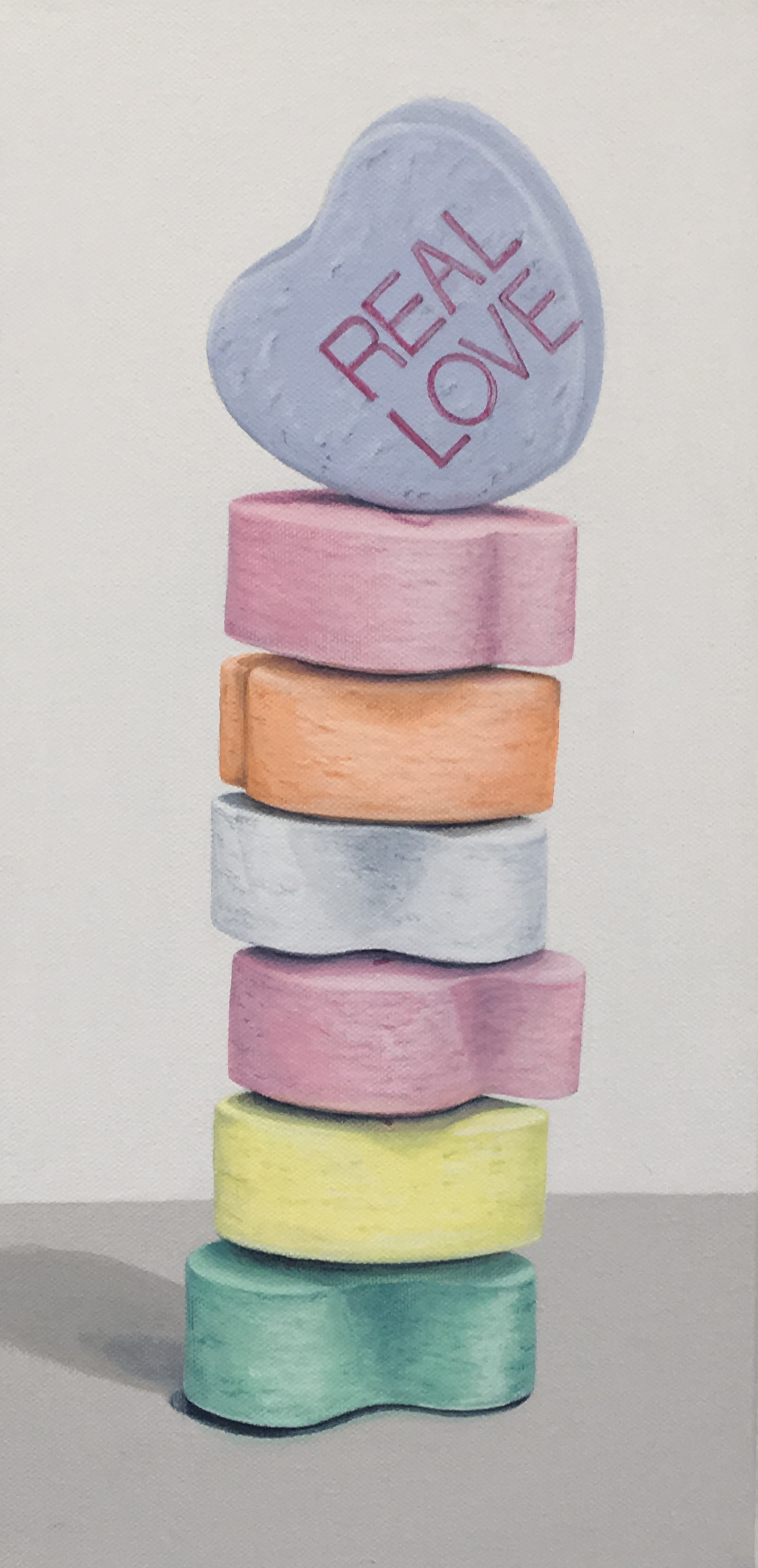 "Totem: Converation Hearts  This little stack of candy hearts are the iconic Valentine sweet. Each heart has pink printing dispenses tiny bits of advice, often off center, faint or blurry, and occasionally nonsensical.     Simon Breitbard Fine Arts    http://sbfinearts.com ,  415-951-1969   8"" x 16"" gallery wrapped canvas  $400.00   SOLD"