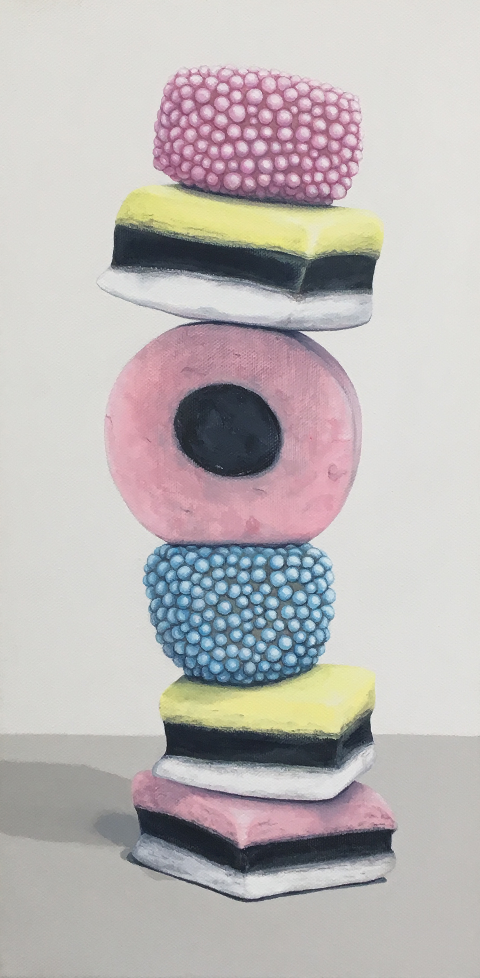 """Totem: Allsorts I   This totem is composed of bright licorice candies. Allsorts are enchanting shapes and colors, including some enticing gelatin nonpareils covered pieces. The first try can be a taste disaster for those who do not adore licorice but are tempted by the all sorts' delightful appearance.   Currently available through Simon Breitbard Fine Arts   http://sbfinearts.com ,  415-951-1969   8"""" x 16"""" gallery wrapped canvas  $400.00   SOLD"""