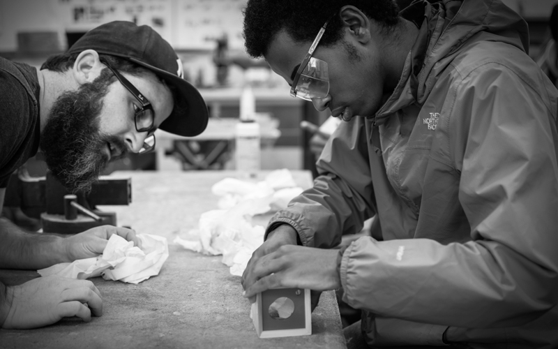 Me giving Aden a hand constructing his sound box.