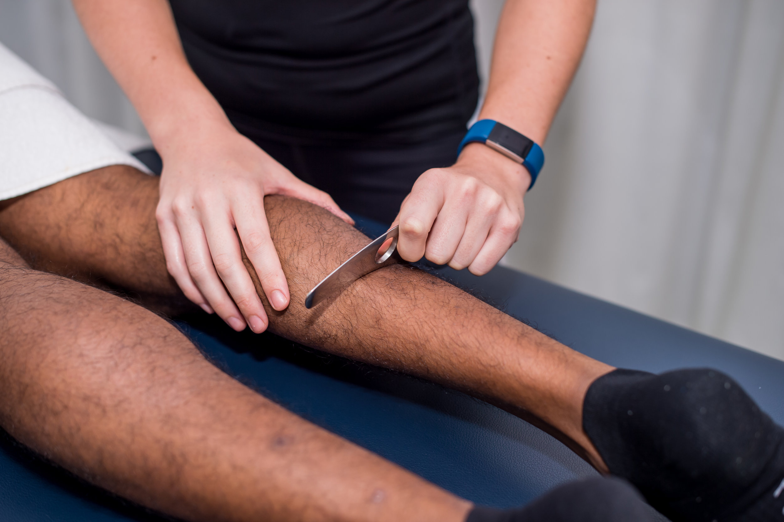 Use of the IASTM tool to add shearing stress to soft tissue in order to enhance the body's healing response.
