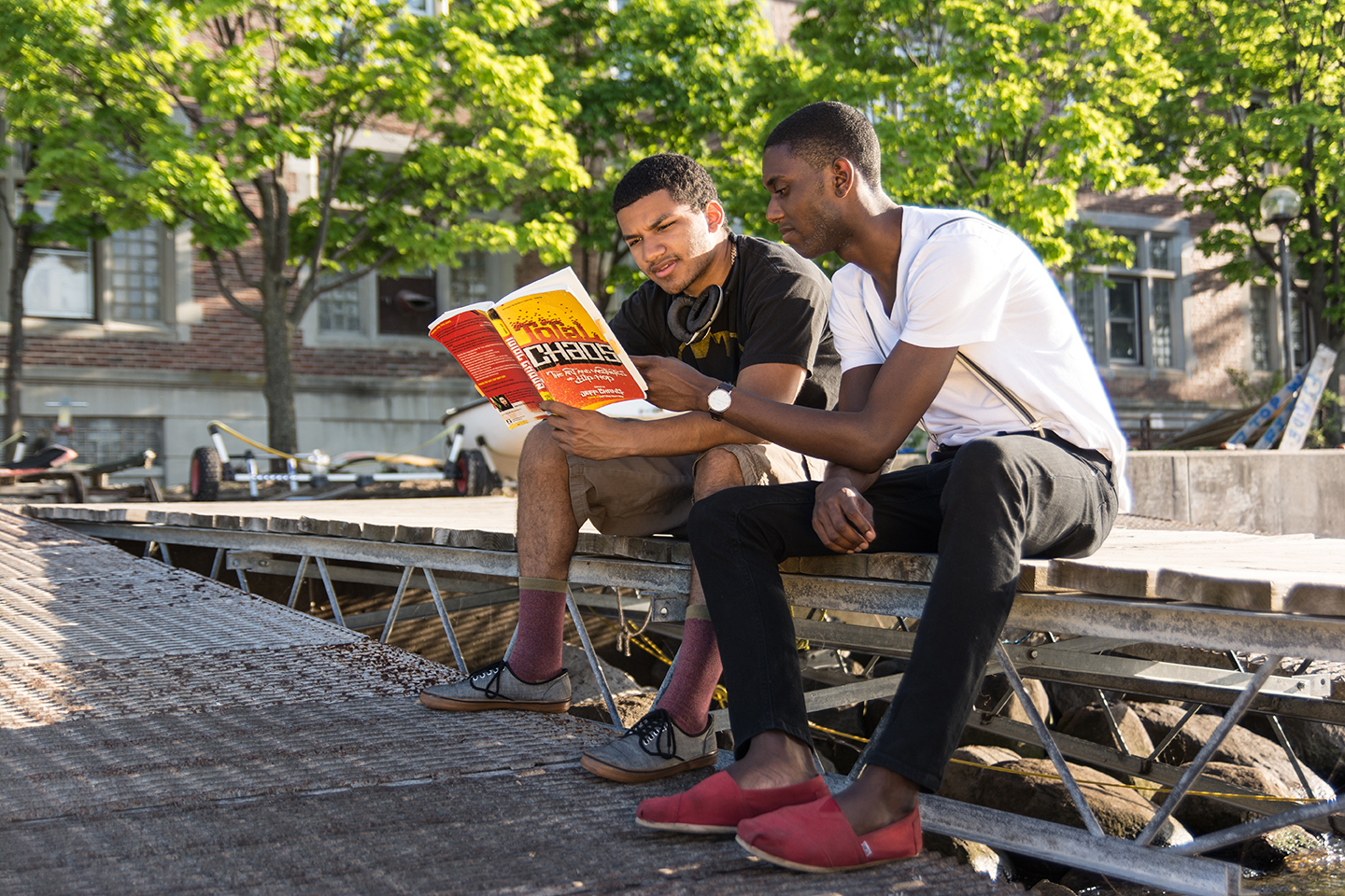 """University of Wisconsin - Madison, First Wave  students  Sean Medlin  and  Christian Robinson  reading Jeff Chang's """"Total Chaos"""".  Photo by Bradlee Bertram of BMB Graphics."""