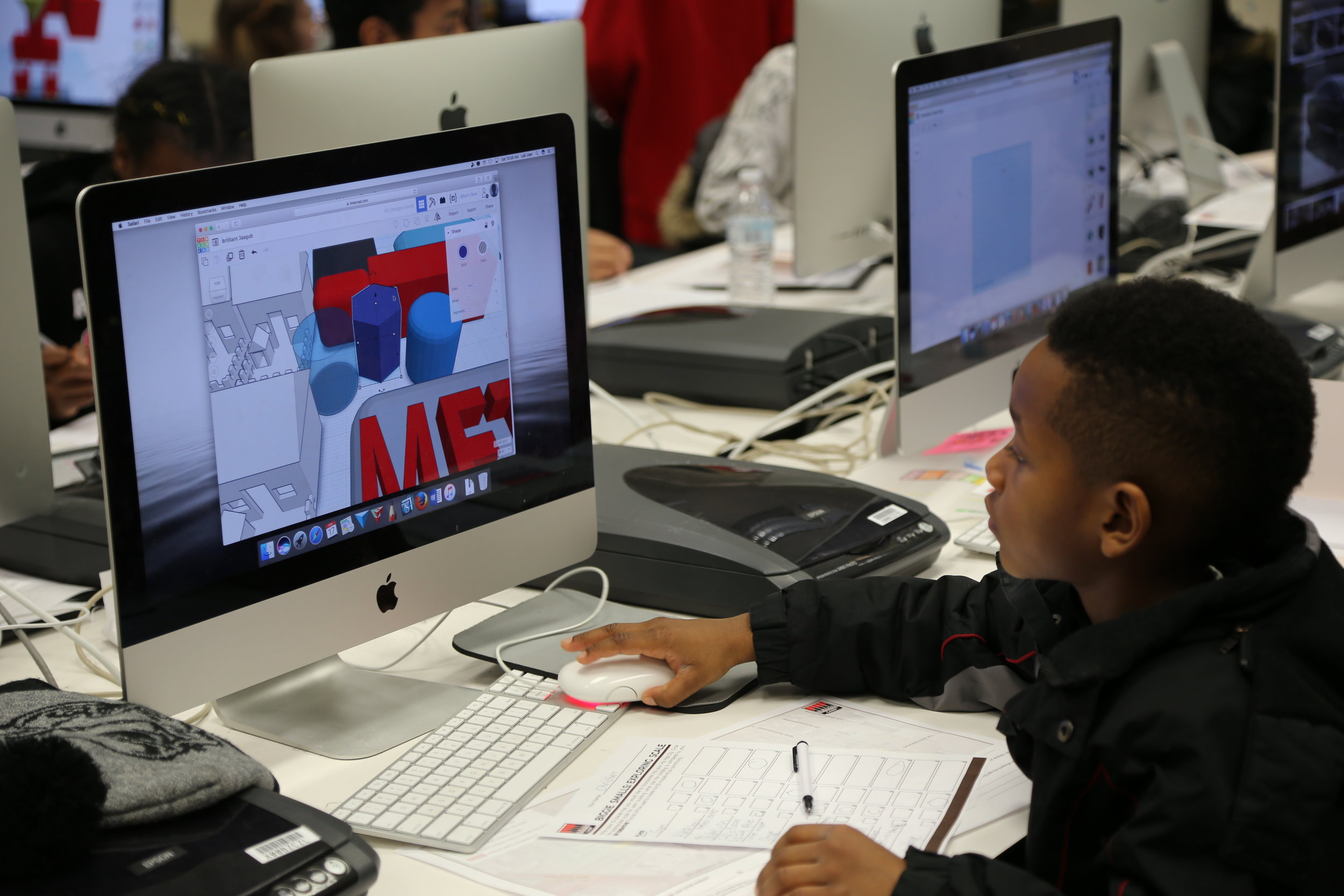 TINKERING AROUND Christian Adams, 9, uses the design program Tinkercad to imagine a new city ROLANDA MASSEY—HIP HOP ARCHITECTURE